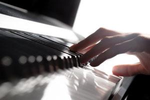 Closeup photo of fingers playing piano